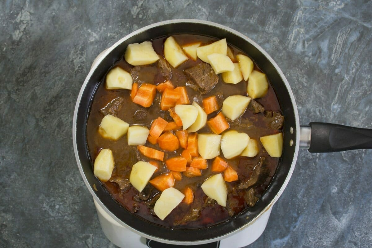 Step 5 Add Potatoes And Carrots To Stew