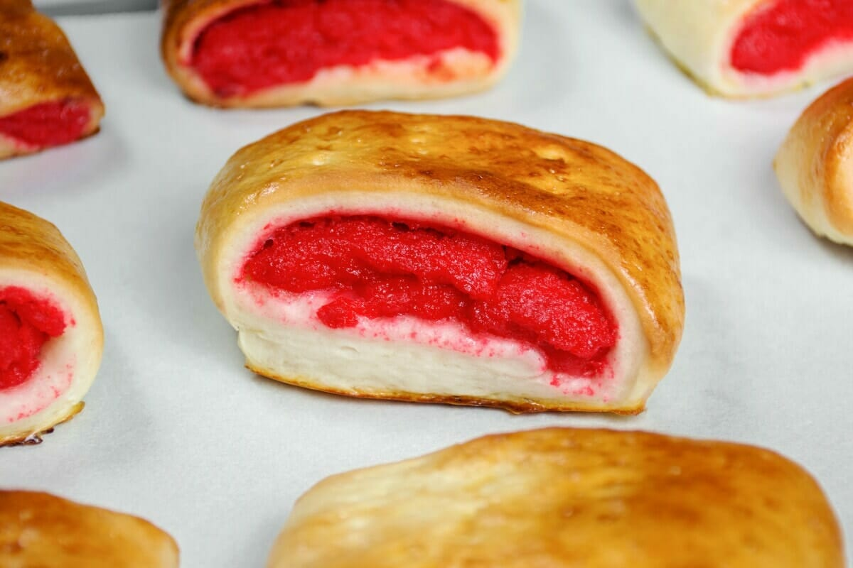 Close Up Of Baked Kalihim Bread With Red Filling