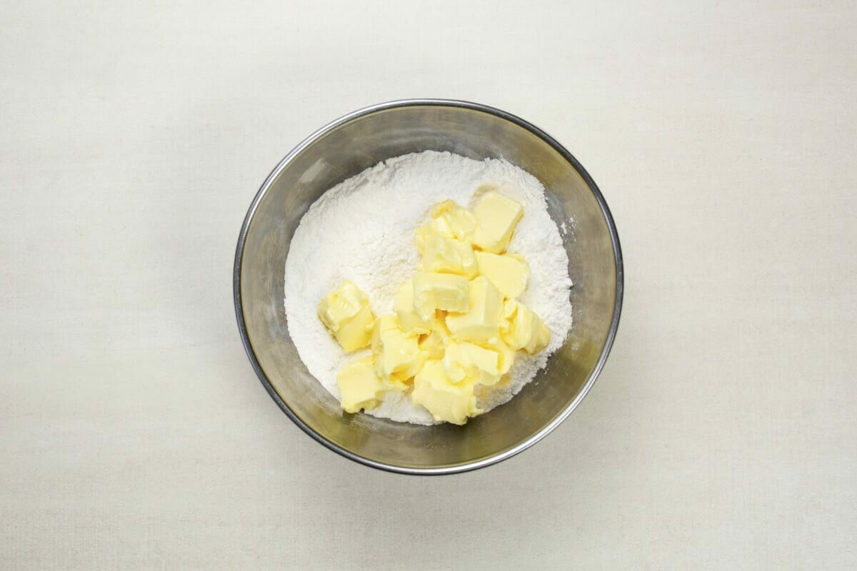 step 2 cubes of butter in flour in bowl