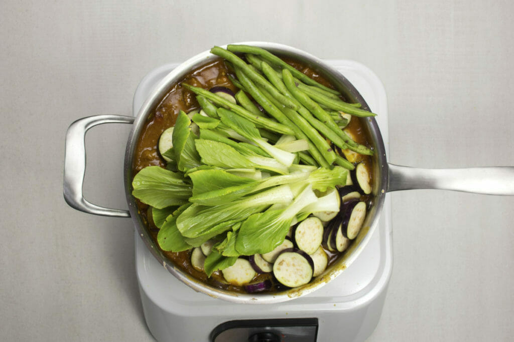step 10 add green beans eggplant bok choy to sauce